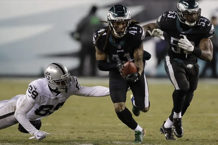 Cornerback Ronald Darby runs with the football after a late fourth quarter interception in the Eagles' 19-10 win against the Raiders.
