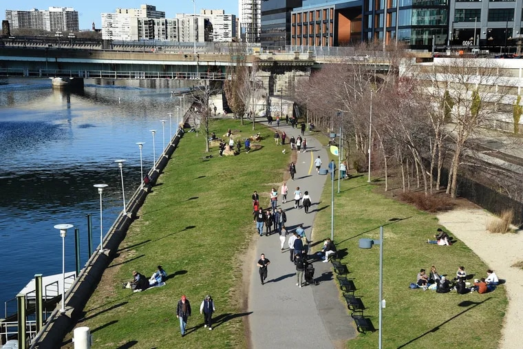 Despite the commands for social distancing, city dwellers still want to be out in the world, and people are out along the Schuylkill River Trail on March 15, 2020.