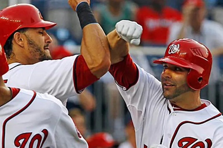 Danny Espinosa, right, celebrates after hitting one of his two home runs off of Cliff Lee. (Ann Heisenfelt/AP)