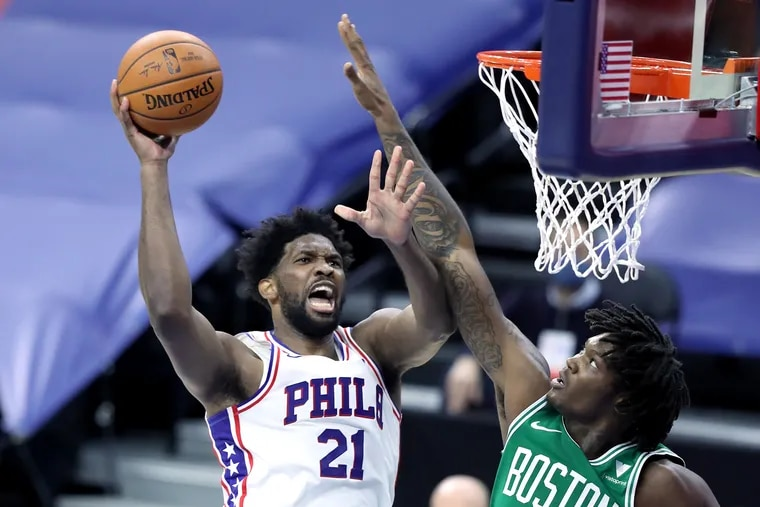 Joel Embiid of the Sixers scores against Robert Williams of the Celtics during the first half.