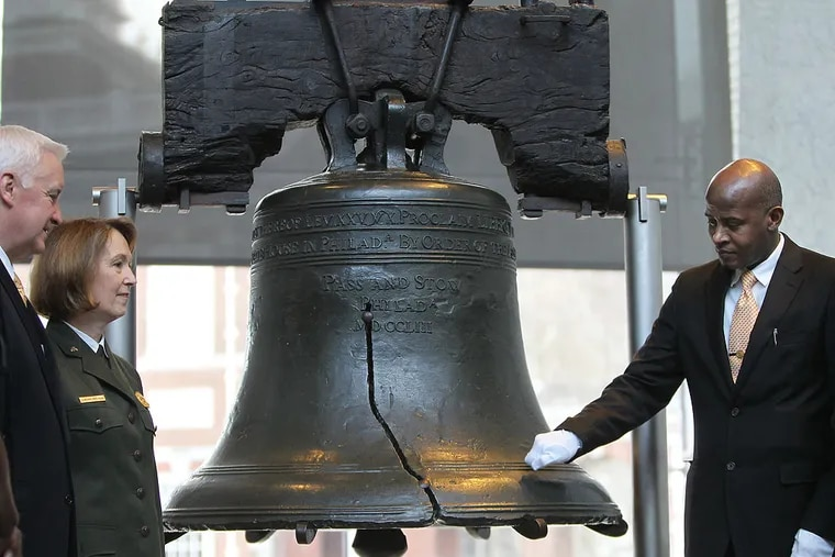 South African Consul General George Monyemangene, right, taps on the Liberty Bell as Gov. Tom Corbett, left, and Superintendent of Independence National Historical Park Cynthia MacLeod, second from left, take part in the annual National Bell Ringing event at the Liberty Bell in Philadelphia, Pa. on January 20, 2014. The symbolic bell tapping was organized by the Philadelphia Martin Luther King, Jr. Association for Non-Violence to honor Dr. King. ( DAVID MAIALETTI / Staff Photographer )