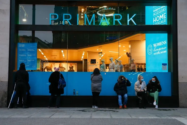 Customers line up outside a Primark clothing store ahead of its reopening on Oxford Street in London on April 12.