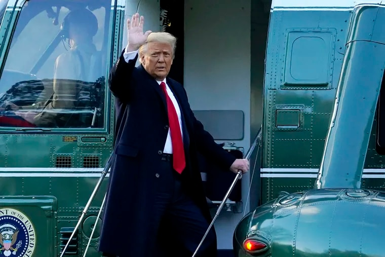 President Donald Trump waves as he boards Marine One on the South Lawn of the White House, Wednesday, Jan. 20, 2021, in Washington. Trump is en route to his Mar-a-Lago Florida Resort.