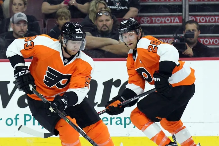 Either Jake Voracek (left) or Claude Giroux (right) had played in every Flyers game in the last 12 years, until they were both sidelined Thursday against the visiting New York Rangers.
