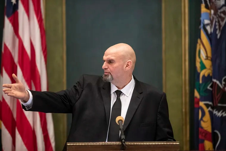 Lt. Gov. John Fetterman chucked his normal wardrobe for a newly purchased charcoal suit (from a big and tall men's store near Braddock), a new white dress shirt with 48-inch sleeves, and an extra-long black tie, to take his oath of office in the Senate chamber.
