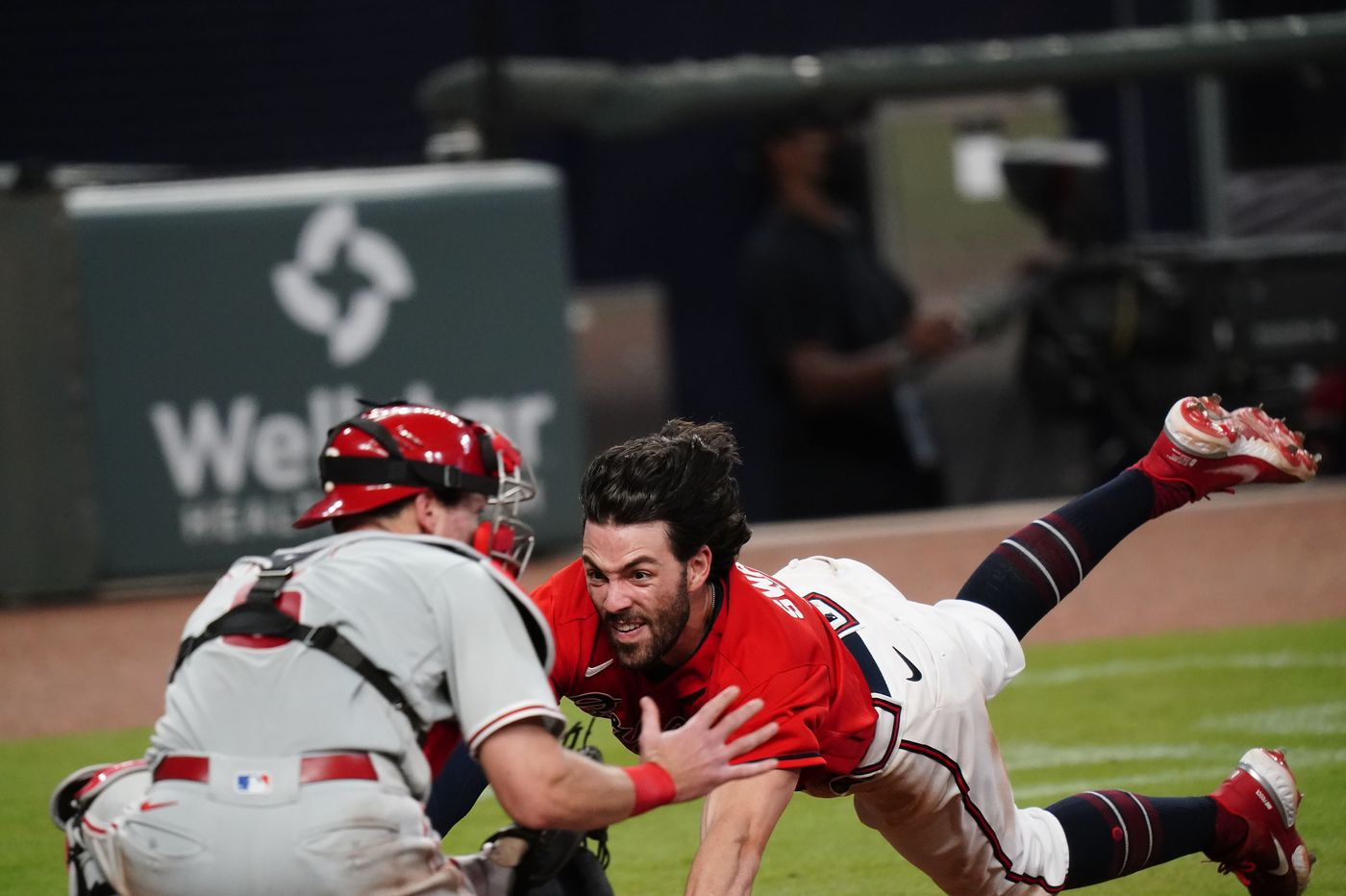 Andrew Knapp's tag broke the rules, Braves manager Brian Snitker says | Extra Innings