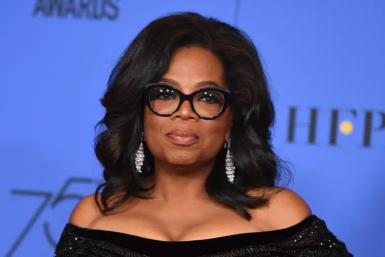 """FILE - In this Jan. 7, 2018 file photo, Oprah Winfrey poses in the press room with the Cecil B. DeMille Award at the 75th annual Golden Globe Awards in Beverly Hills, Calif. Winfrey will interview two men who say Michael Jackson sexually abused them as boys immediately after a documentary on the men. HBO and the Oprah Winfrey Network announced Wednesday that """"After Neverland,"""" will air on both channels Monday at 10 p.m. Eastern and Pacific."""