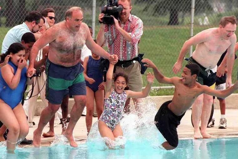 During his tenure as mayor, Ed Rendell gathered a group of children together to inaugurate the reopening of a swimming pool in Hunting Park. Also on hand was the city's police commissioner, John Timoney (right).