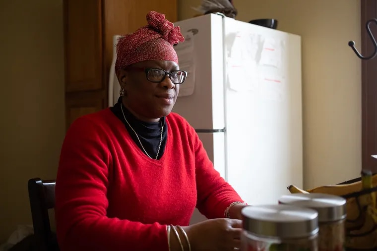 Annie Johnson sits in her home in the Stenton section of Philadelphia Sunday, March 3, 2019. Johnson is a former nanny who hasn't been able to find a nannying job in Philadelphia that she feels pays a decent wage.