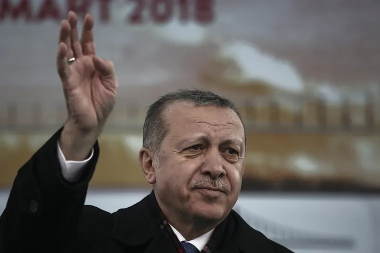Turkish President Recep Tayyip Erdogan waves to supporters during a ceremony on March 18, 2018.