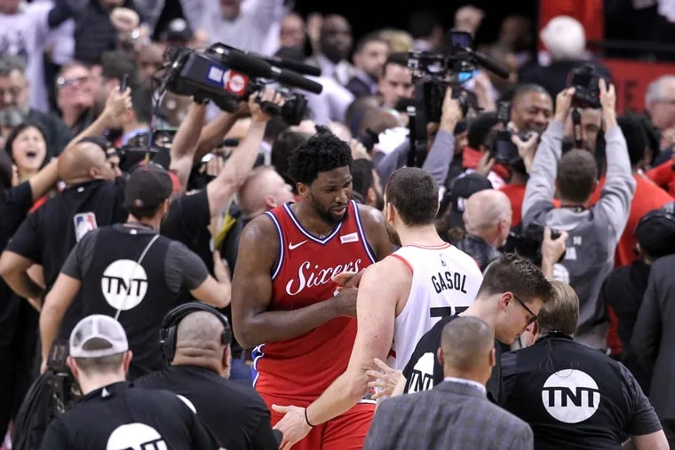 Joel Embiid is comforted by the Raptors' Marc Gasol following the Sixers' Game 7 loss.