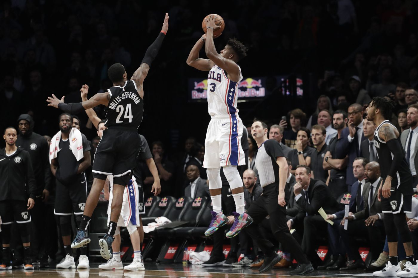 Jimmy Butler's last-second three-pointer lifts Sixers to win over Nets