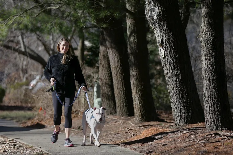 Ashley Greenblatt walks with her dog, Lincoln, near her home in Voorhees, N.J. Walking is the most convenient workout since it's free and requires no equipment. If you're walking for weight loss, keep it brisk and challenging by incorporating inclines. Aim for 30 minutes, five times a week.