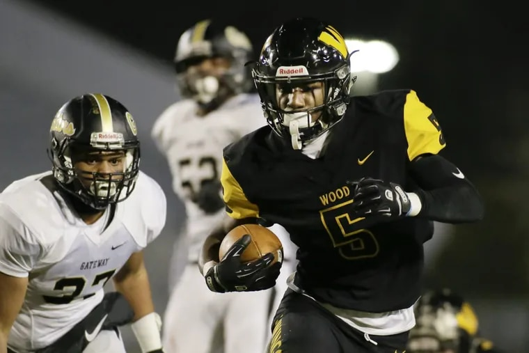 Nasir Peoples (5) sparked Archbishop Wood's drive to a fifth state title  by rushing for 1,838 yards and 29 scores.