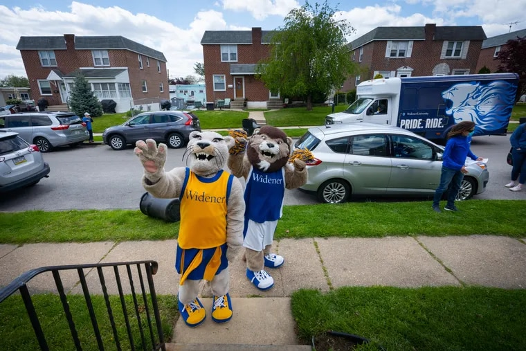 """Widener Mascots Morgan Kent, left, and Kevin DeSimone, right, visit the neighborhoods of students who were accepted to Widener University in the fall, in Delaware County, May 12, 2020. Many of them had not yet committed to attend and the university wanted to let them know """"we'd love to welcome them to Widener for the fall,"""" a spokesperson said. Like at many campuses, the university's freshmen deposits are down."""