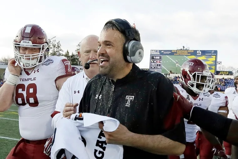 Temple head coach Matt Rhule has the water cooler dumped on him at the end of the Temple vs. Navy AAC Championship football game at Navy–Marine Corps Memorial Stadium in Annapolis, Md. on December 3, 2016.  Temple won the AAC Championship 34-10.