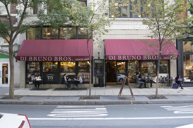 DiBruno Bros., shown here at 1730 Chestnut St. in Center City, and restaurants that sell wine by the bottle to go are pushing for the state to reopen their supply channel.