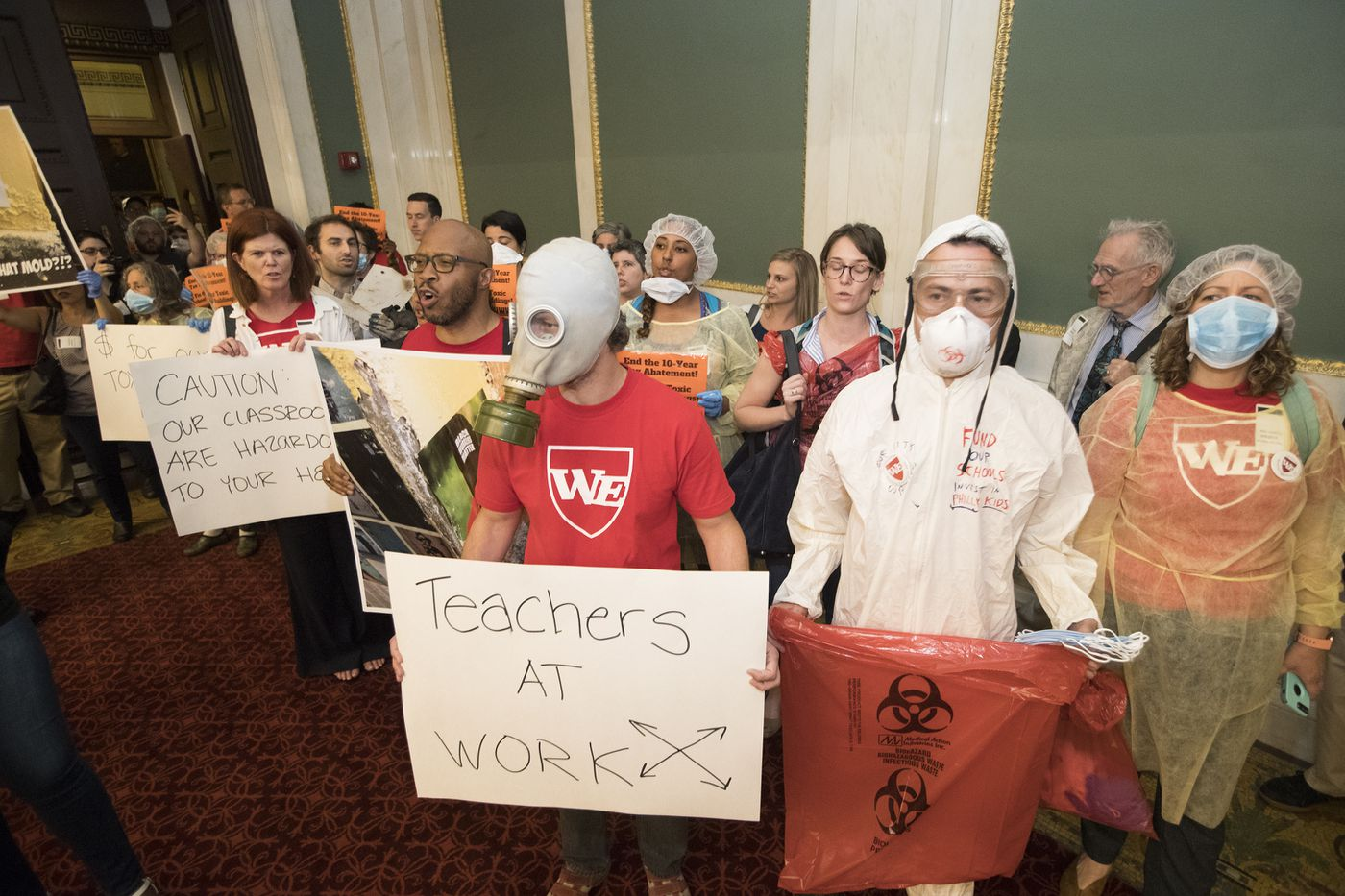 Teachers led by Our City, Our Schools descended on City Council with evidence of the toxic conditions inside their schools on June 5, 2018. They are urging increased funding of schools. They are shown entering Council Chambers.