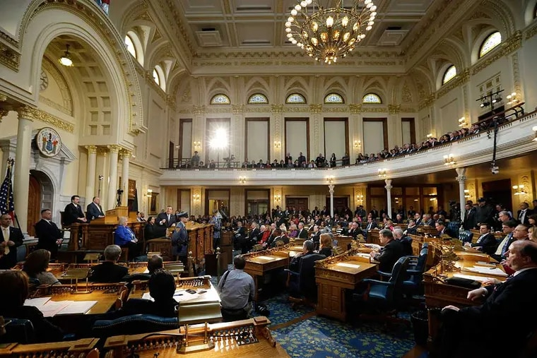 The crowd in the New Jersey Statehouse listens during the governor's budget address in 2014, in Trenton, N.J.  (AP Photo/Mel Evans)
