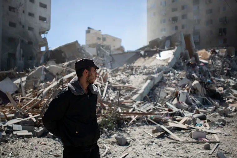 A Palestinian policeman stands in the rubble of a building destroyed by an Israeli airstrike that housed Associated Press offices in Gaza City on Saturday. The airstrike came roughly an hour after the Israeli military ordered people to evacuate the building. There was no immediate explanation for why the building was targeted. The building housed the Associated Press, Al Jazeera, and a number of offices and apartments.