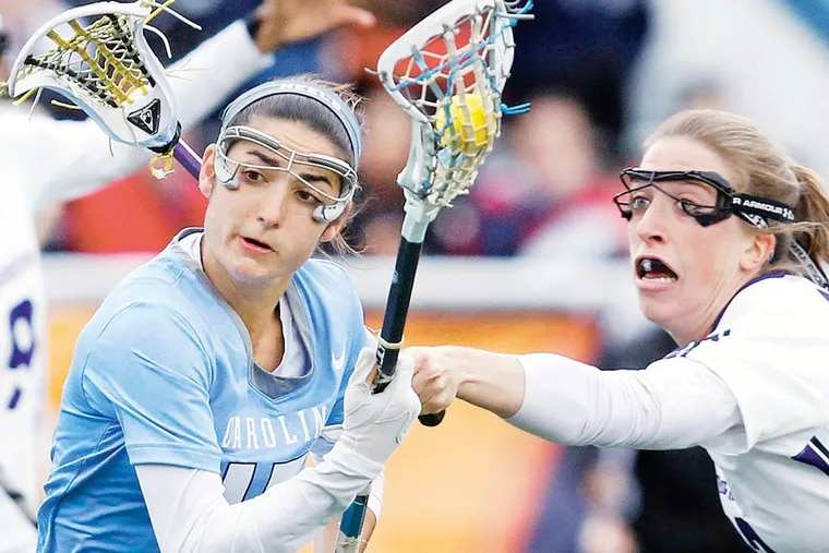 North Carolina's Kara Cannizzaro gets past Northwestern's Brooke Jones in NCAA Women's Lacrosse Final Four at Villanova on Friday, May 24, 2013.   ( RON CORTES / Staff Photographer ).