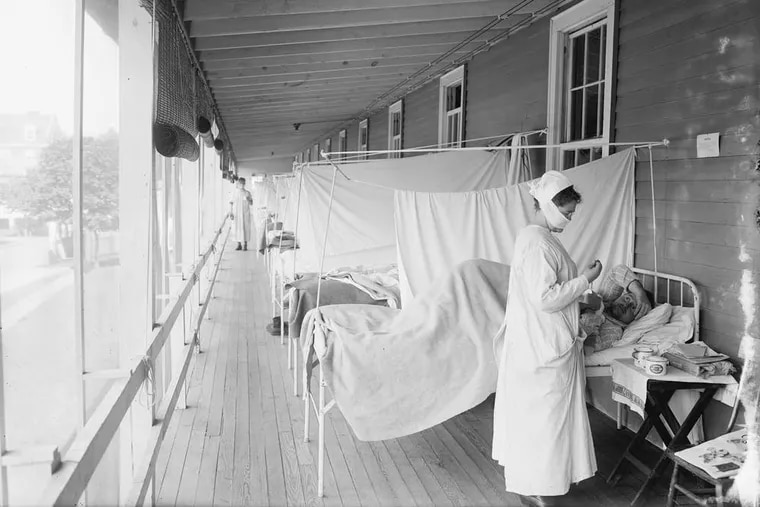 Patients receive care for the flu in 1918 at Walter Reed Military Hospital, in Washington, D.C.