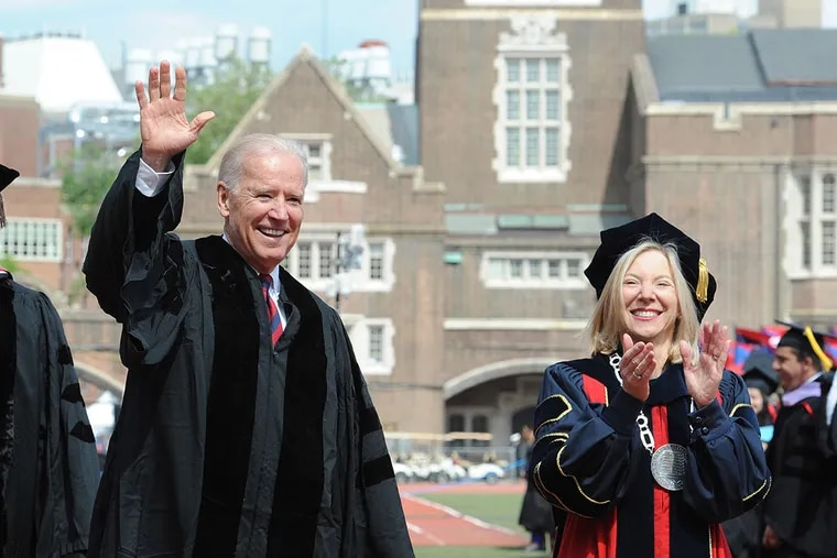 Joe Biden, then vice president, waves to the crowd as he and University of Pennsylvania President Amy Gutmann enter Franklin Field for the university's 257th commencement exercises May 13, 2013.