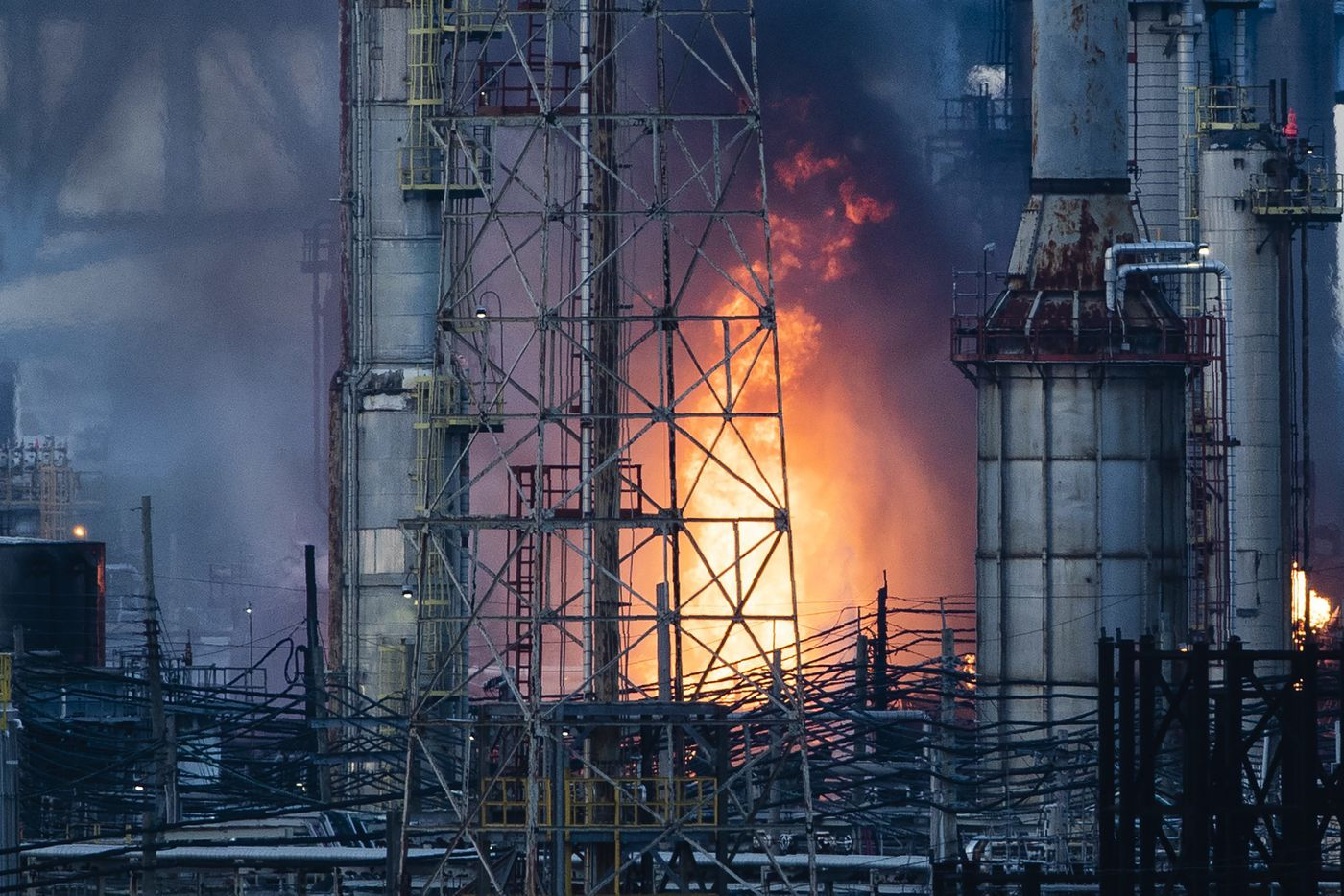 Flames and smoke emerge from the Philadelphia Energy Solutions Refining Complex in Philadelphia, Friday, June 21, 2019.
