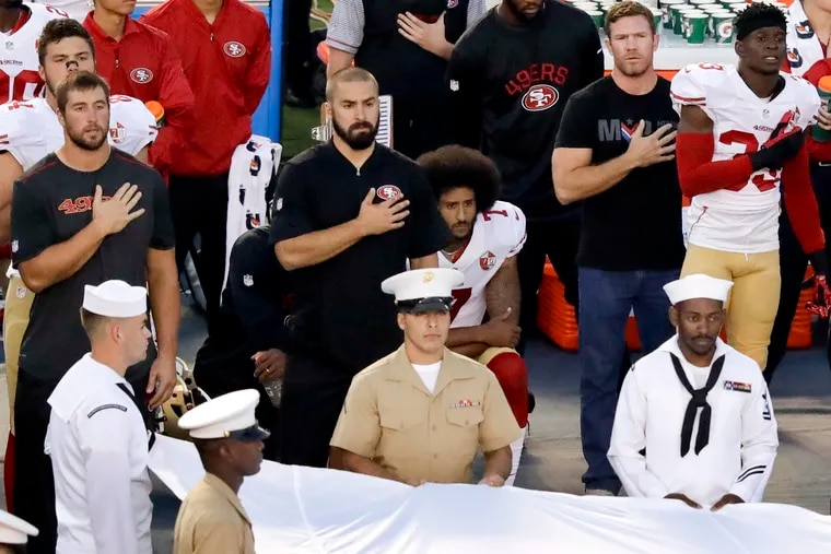 Colin Kaepernick kneels during the national anthem before a game in 2016.