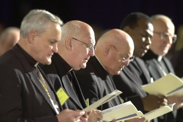 Bishops sing a hymn during the opening of Friday morning session at the U.S. Conference of Catholic Bishops meeting in Dallas, Friday, June 14. 2002.