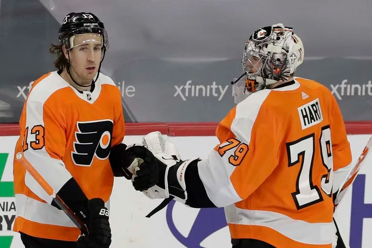 Center Kevin Hayes, shown celebrating earlier this season with goalie Carter Hart, and the Flyers are hoping to have more stability in their lineup. The team is almost healthy after being hit hard by COVID-19.