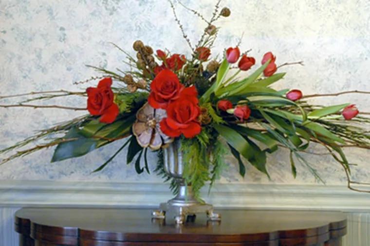 Holiday arrangement by floral designer Jane Godshalk. (Ron Tarver / Staff Photographer)