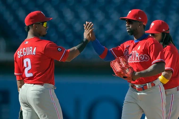 The Phillies' Andrew McCutchen (right) drove in four runs to lead a six-run comeback and a sixth straight win.