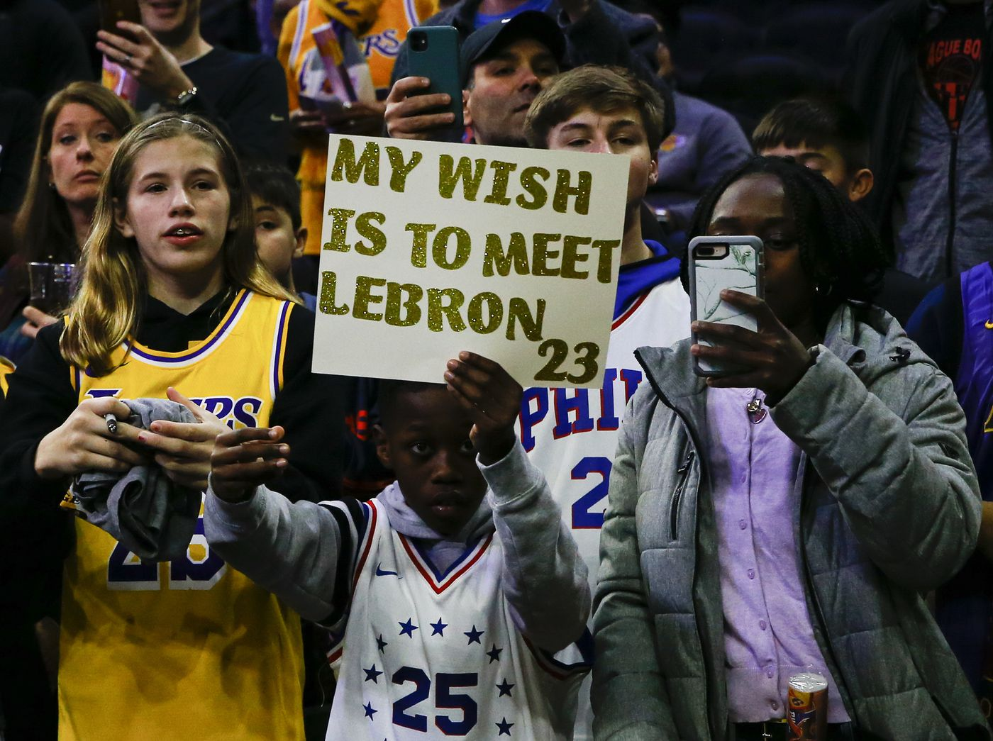 Fans wait for Los Angeles Lakers forward LeBron James before the Sixers play the Lakers on Saturday, January 25, 2020 in Philadelphia.