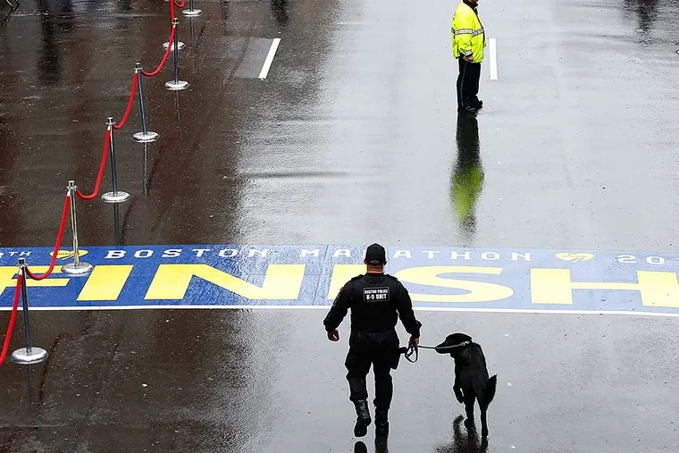 Police patrol the finish line of the Boston Marathon on the one-year anniversary of the bombings. A moment of silence was held at 2:49 p.m., the time the first bomb went off. JARED WICKERHAM / Getty Images