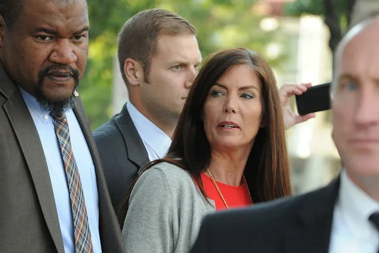 Pennsylvania Attorney General Kathleen Kane walks out of the Montgomery County Courthouse in Norristown after a preliminary hearing on charges against her including perjury, false swearing and obstruction of justice charges.    ( CLEM MURRAY / Staff Photographer )