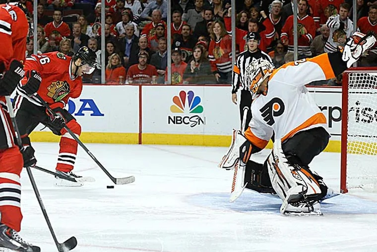 Blackhawks center Michal Handzus scores past Flyers goalie Ray Emery off a pass from Marcus Kruger. (Charles Rex Arbogast/AP)