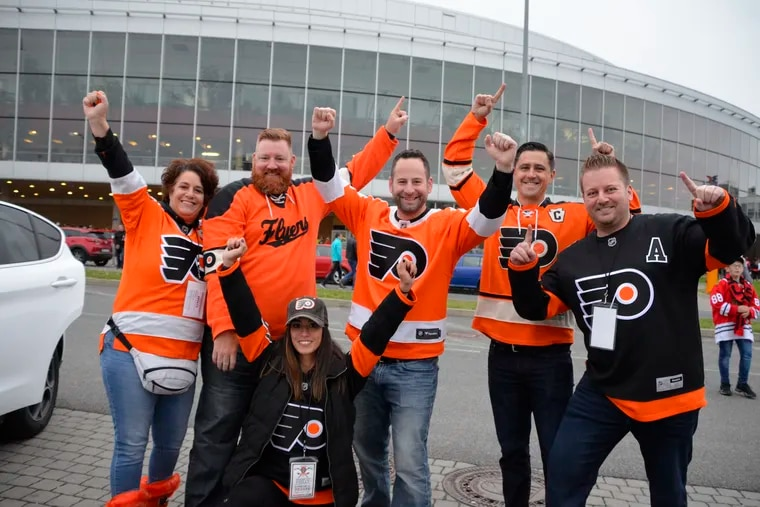 Flyers fans turned out in force in Prague for the season opener at O2 Arena. Kneeling:  Amanda DiStefano of Broomall.  Standing and kneeling, from left to right:  Grace DiStefano of Broomall; Tim Cavanaugh of Springfield; Brian Dikun of West Cheste; Matt Plagens of Williamsport; and Christian Off of Lansdale.