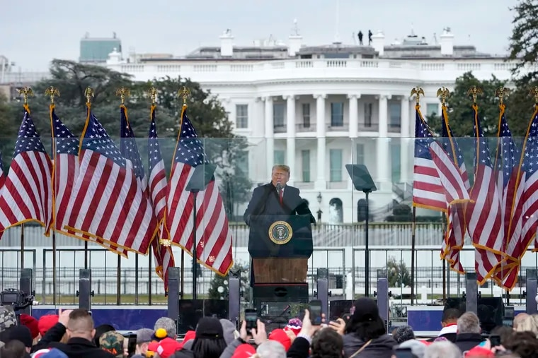 In this Jan. 6, photo with the White House in the background, President Donald Trump speaks at a rally in Washington.