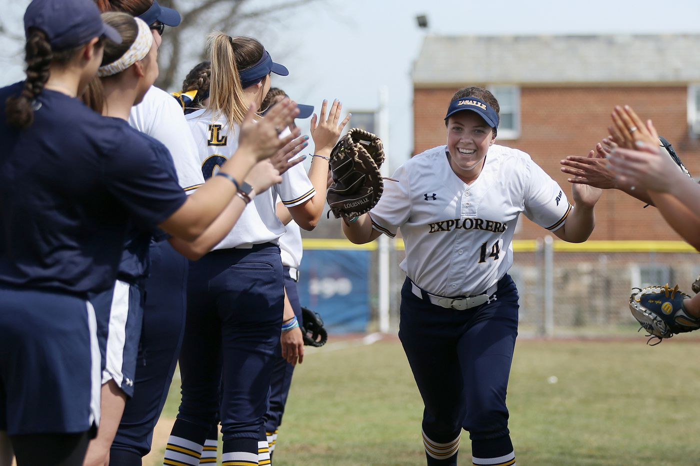 La Salle University's Ashley Mendenhall excels on the softball diamond and in the choir pews