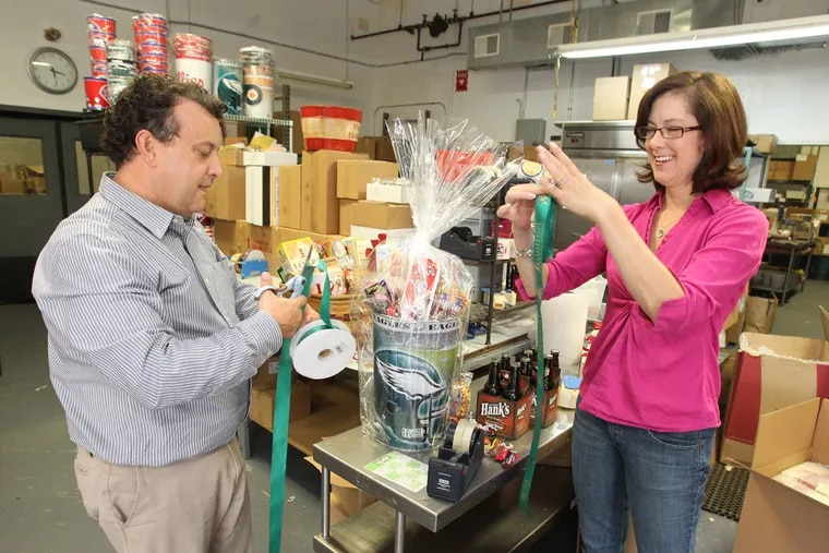 Michael and Julie Holahan of the Pennsylvania General Store put together gift baskets in their warehouse space in Feltonville in March 2012.
