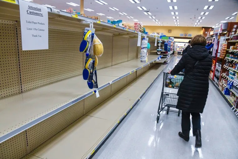 Rosauers customers found the shelves empty of toilet paper during senior and at-risk shopping at the grocery store on 29th Avenue, Thursday, March 19, 2020, in Spokane, Wash.