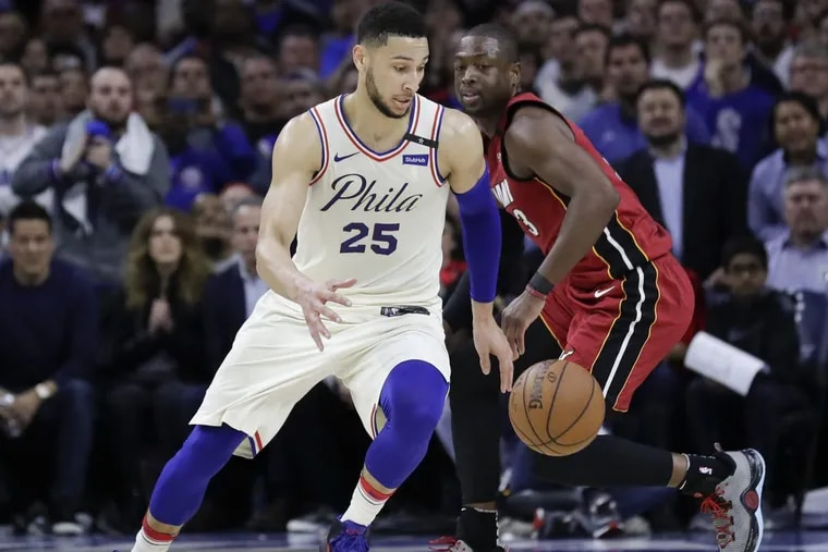 Sixers guard Ben Simmons dribbles against Miami Heat guard Dwyane Wade during game two of the Eastern Conference quarterfinals on Monday.