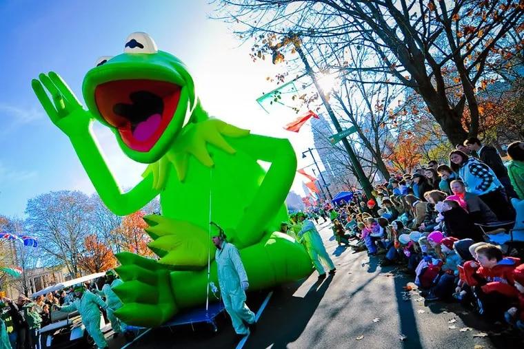A giant Kermit balloon overlooks Philadelphia's Thanksgiving Parade.
