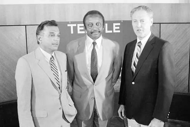 John Chaney poses for a photo with Temple president Peter J. Liacouras (left) and athletic director Gavin White Jr. (right) following Chaney's introductory press conference as the Owls' men's basketball coach back on Aug. 18, 1982.