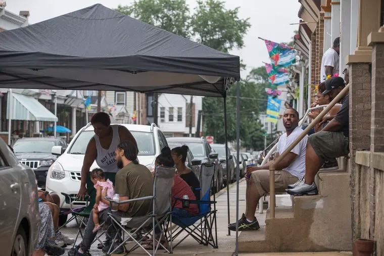 The 5200 block of Marion Street had their request to close the street for a block party on Aug. 11 turned down. The party went on with the street open for traffic on a rainy afternoon.
