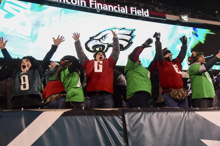 Eagles fans celebrating a touchdown in a victory over the Oakland Raiders at Lincoln Financial Field on Christmas night.