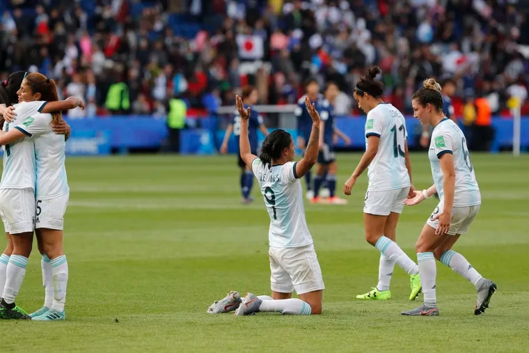 Argentina players celebrate after the final whistle of their tie against Japan.