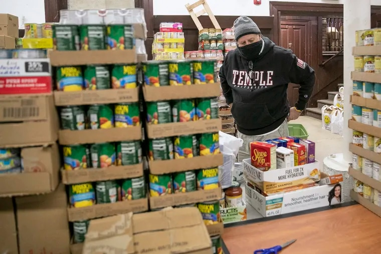 Alex MacMoran visits the basement where food bags to give away to the community are prepared at St. Wilfrid's Episcopal Church in Camden.