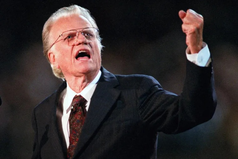 Billy Graham preaches during his 1996 crusade in his hometown of Charlotte, N.C.